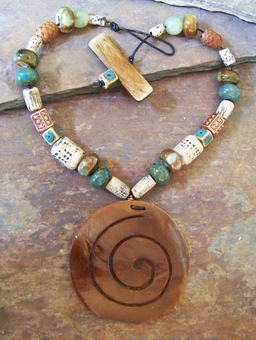Shell pendant, polymer clay beads, ceramic beads, leather, wood