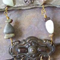 Antique dresser handle, crystals, agates, petrified wood, polished stones