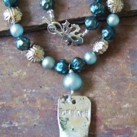 All recycled beads from old vintage necklaces and a stamped paintbrush ferule.
